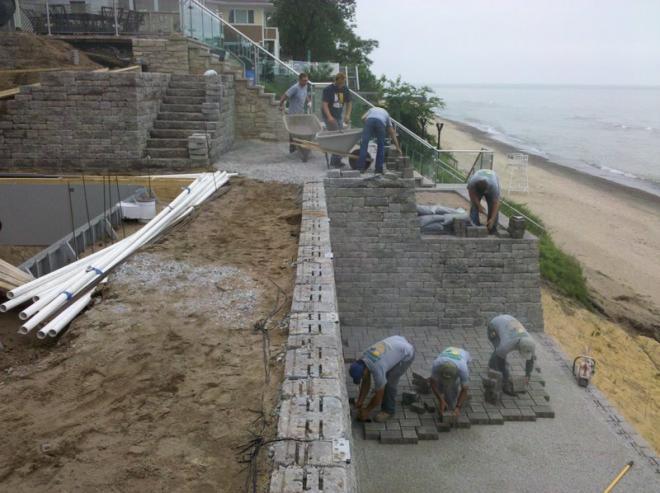 Landscaping team installing retaining walls