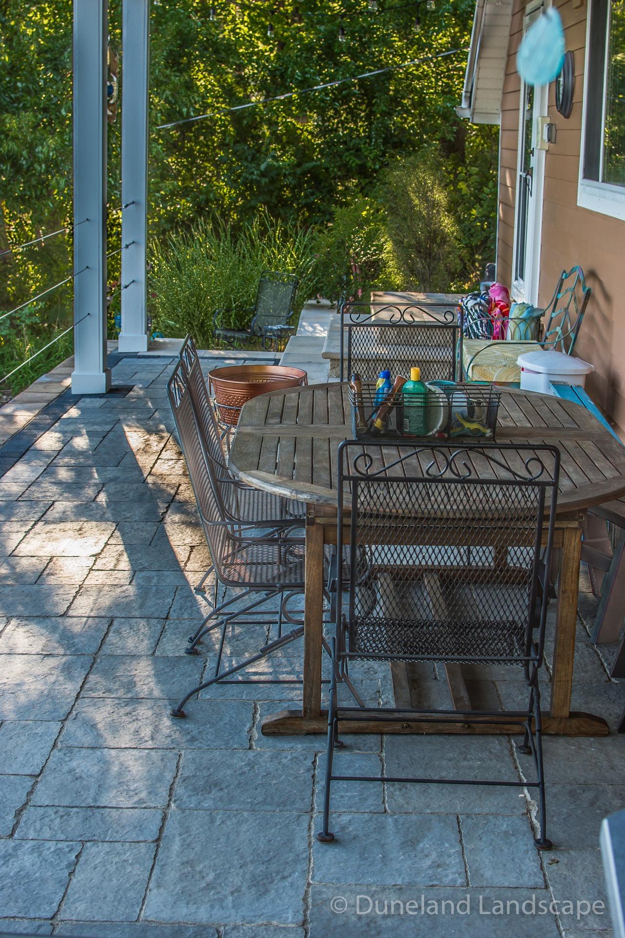 outdoor living space overlooking pool