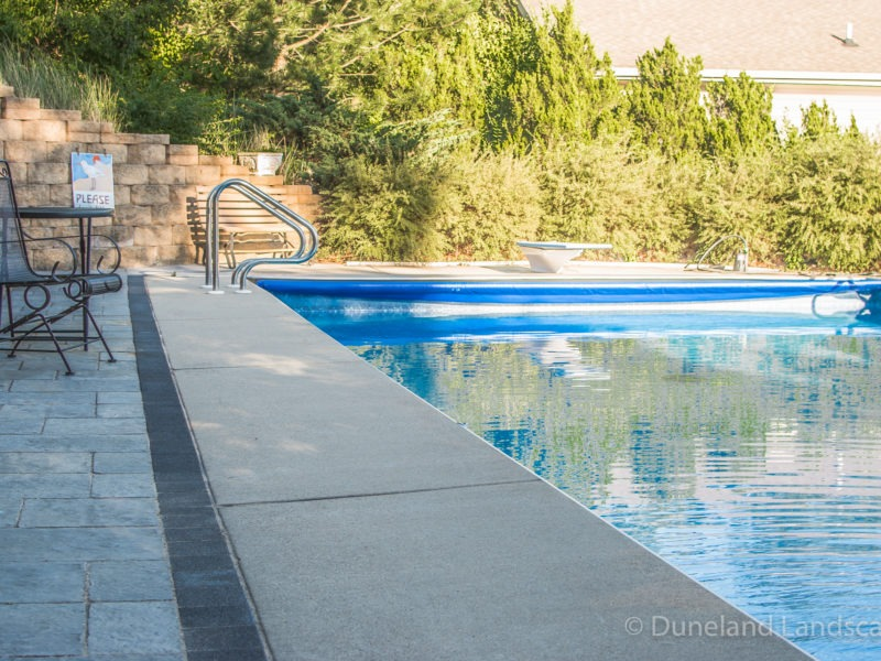sleek concrete patio pool deck