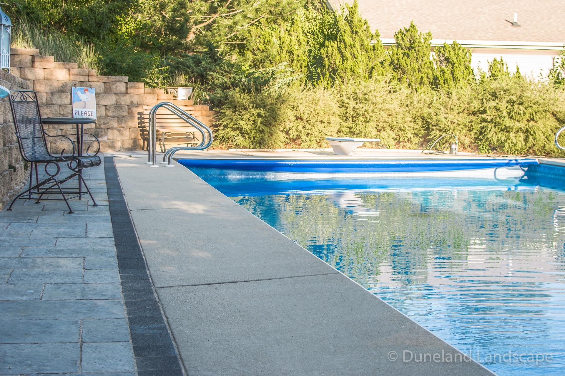 sleek concrete patio pool deck