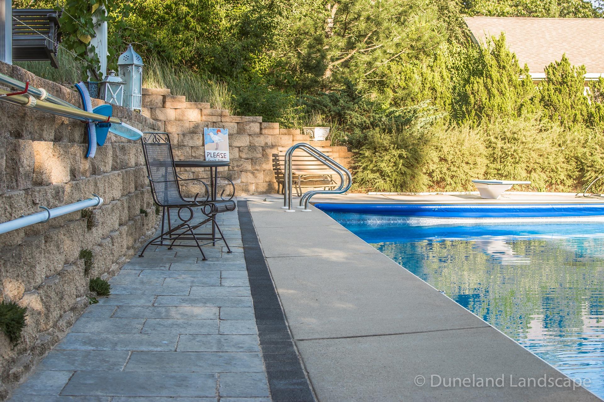 brick and concrete pool patio