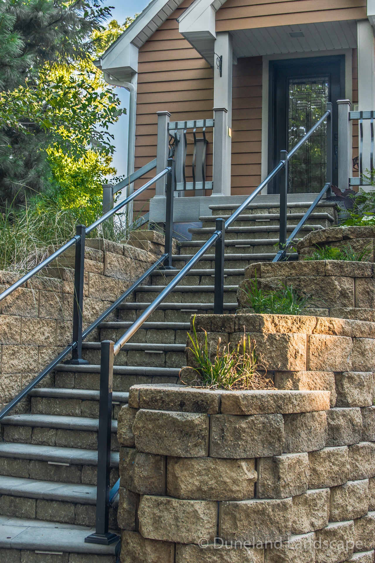 front door curb appeal with paver staircase