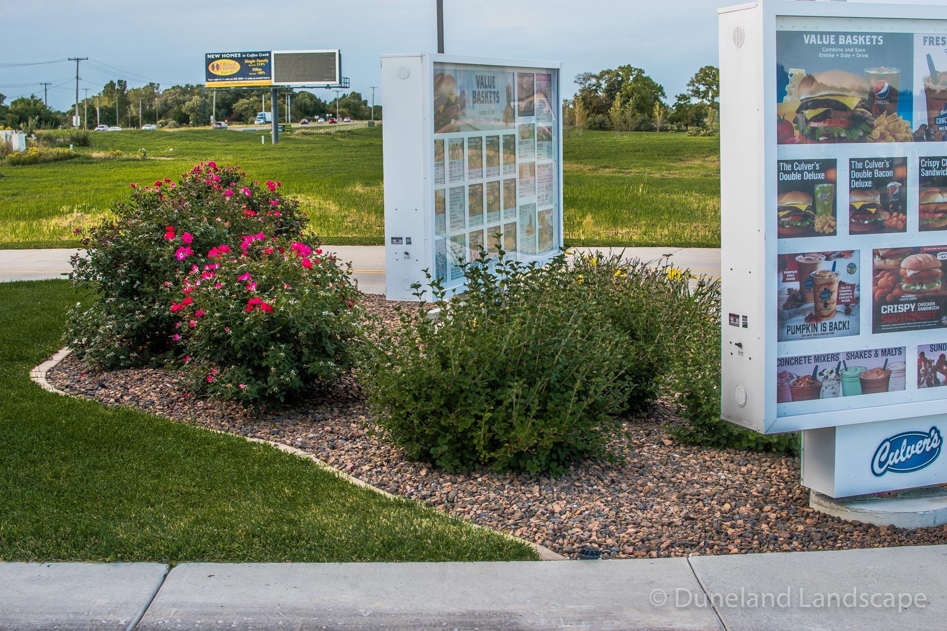 Landscaping at Culver's drive through menu