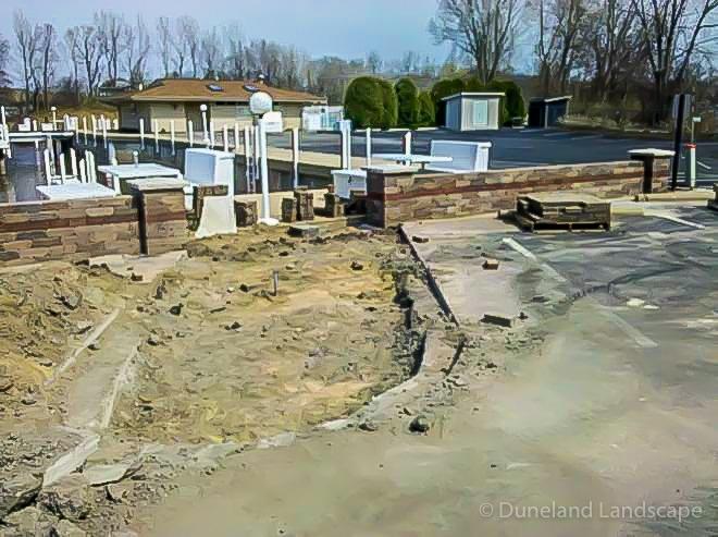 hardscaping demolition in Lake Michigan parking lot