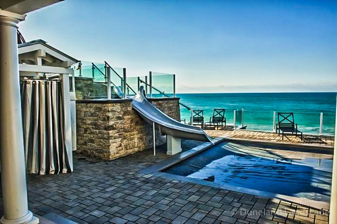 outdoor hardscaping for pool and water slide