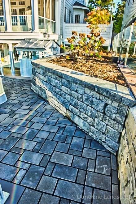 brick patio and all-season landscaping