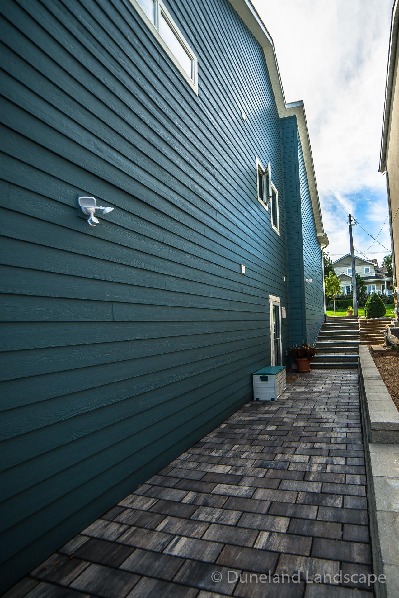 brick sidewalk pavers alongside house