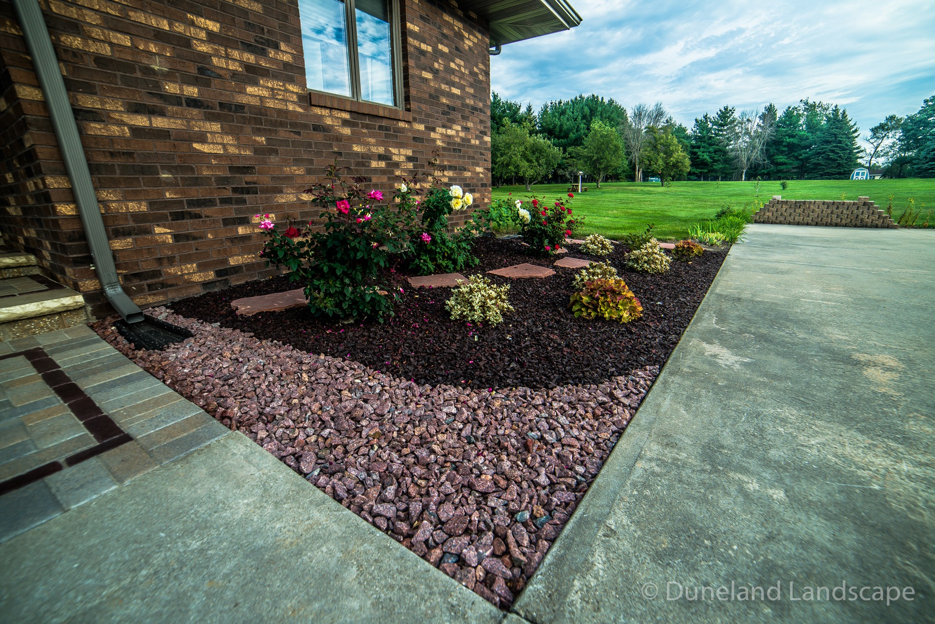 red gravel stones surrounding landscaping