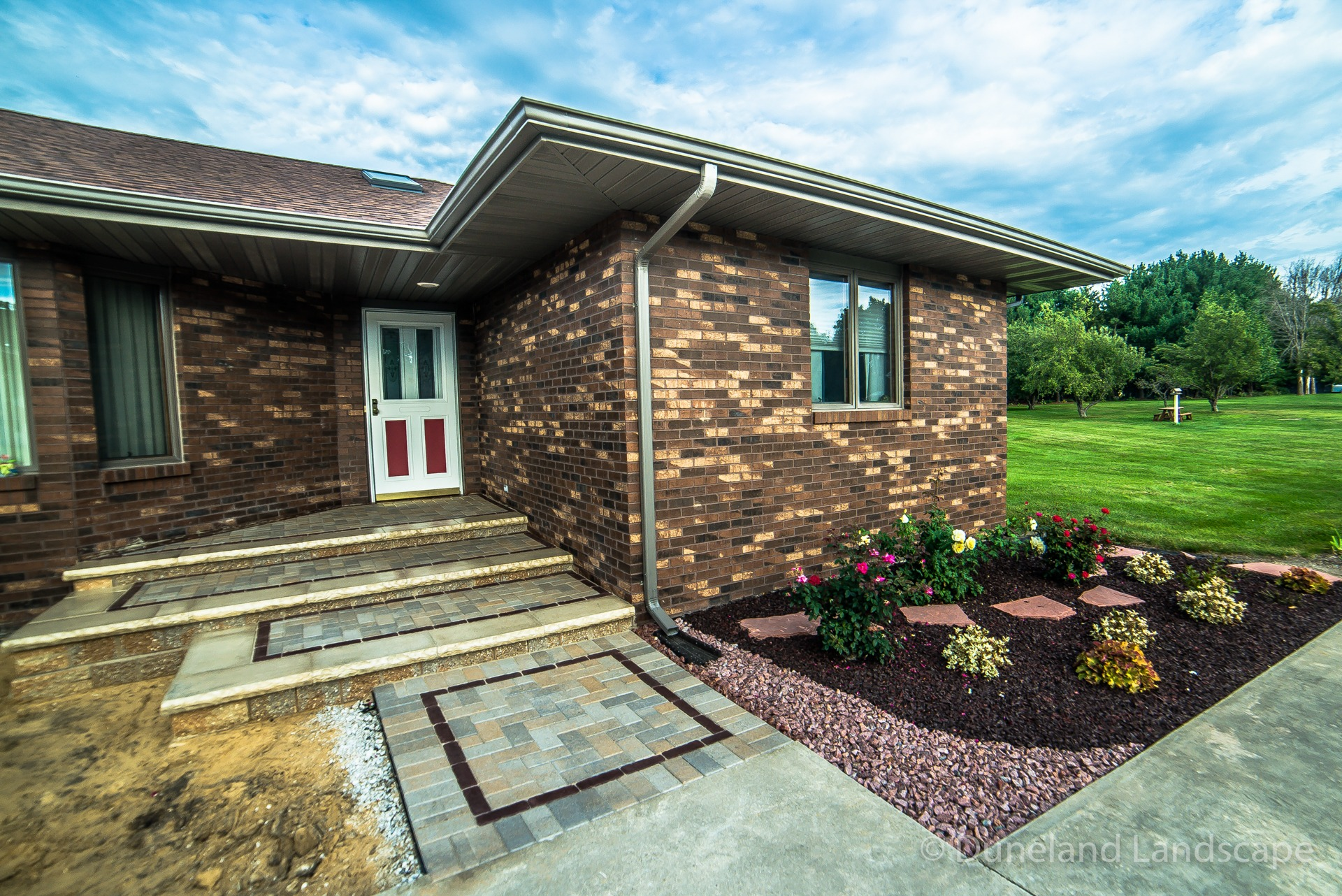 brick porch steps and landscaping