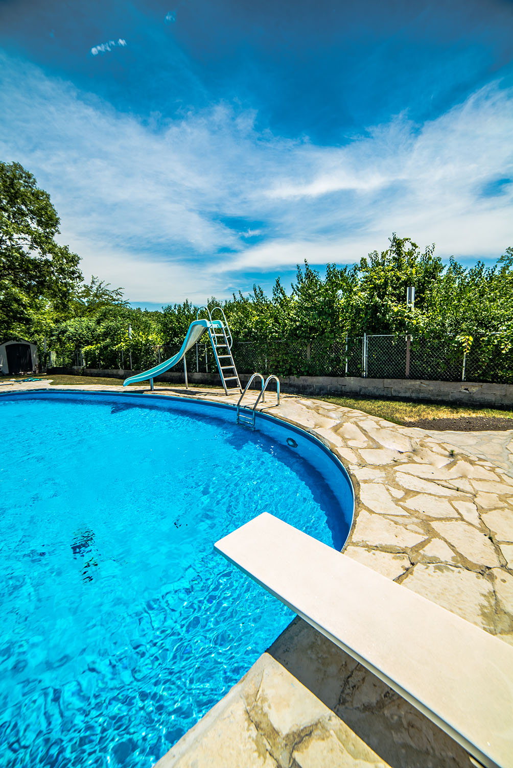 privacy landscape bushes surround outdoor pool