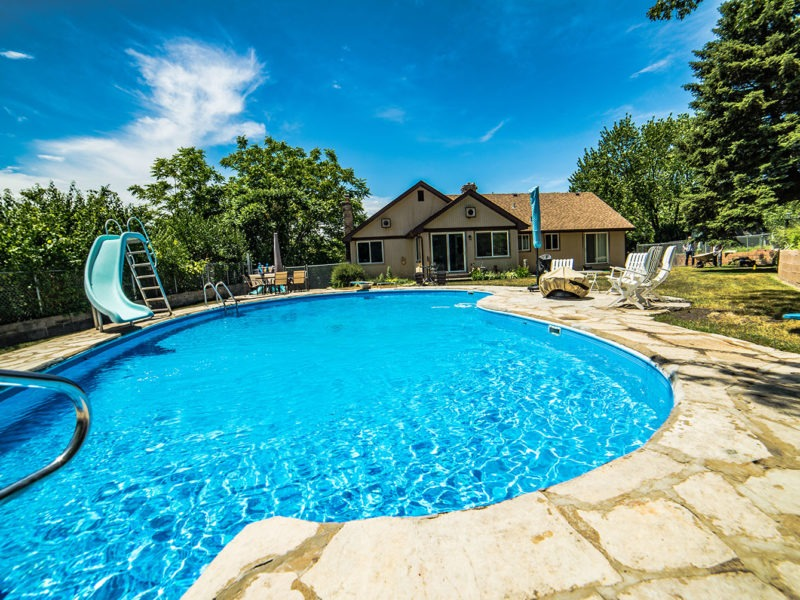 Patio hardscape design with in-ground pool