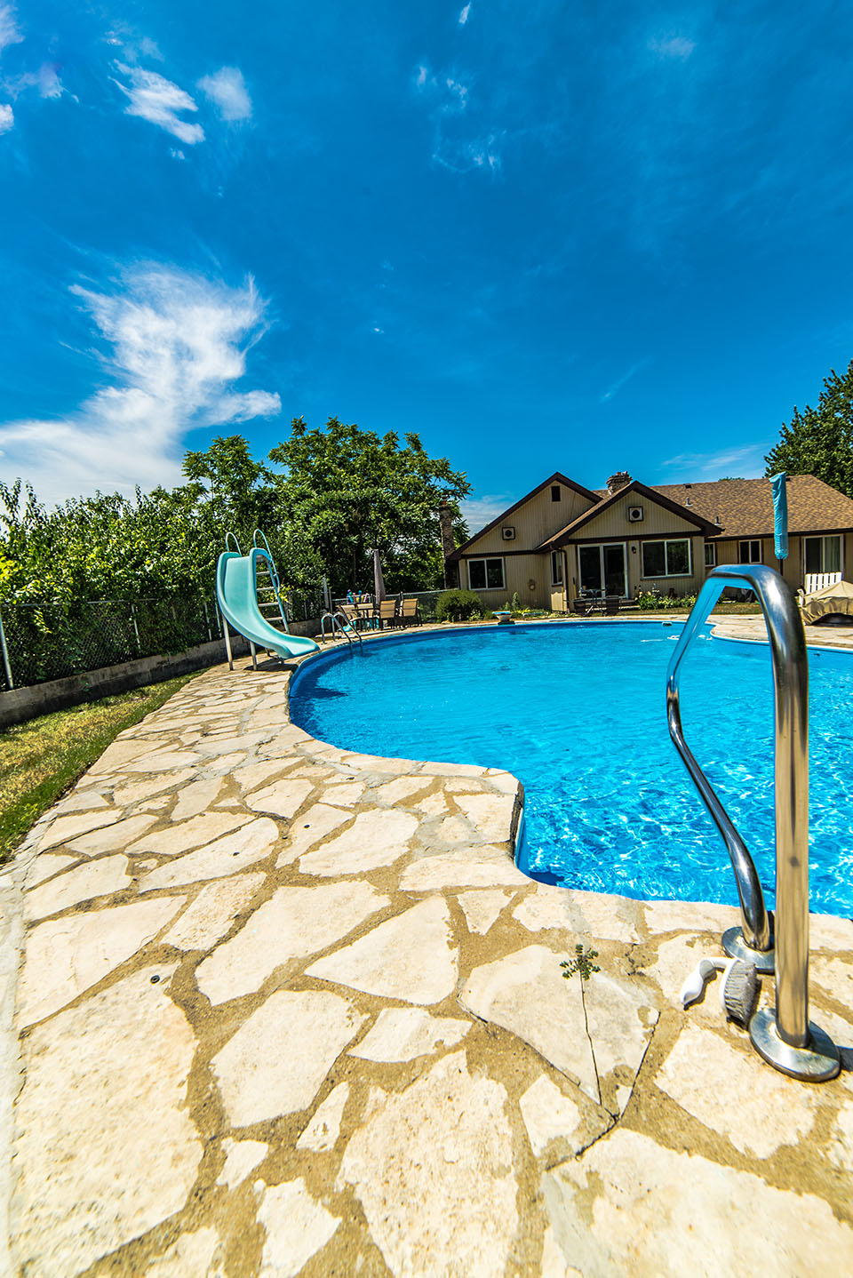 custom pool design and stone pavers