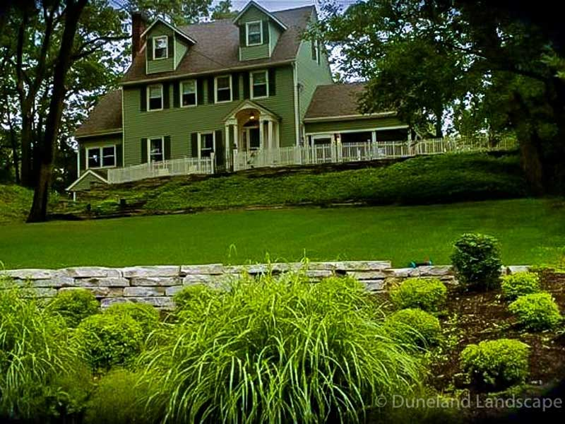 Lawn care and maintenance on many acres of land